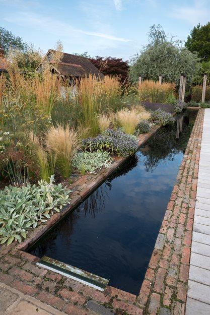 Contemporary english garden garden design for Garden reflecting pool
