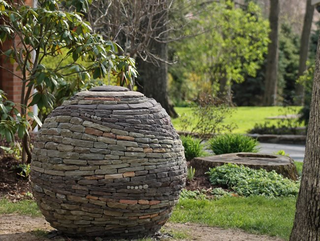 Stacked stone garden sphere garden design for Garden landscaping stones