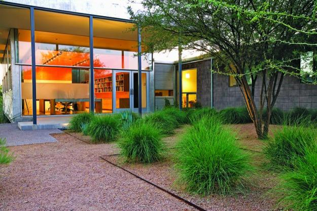 Steel-edged pathway to studio lined with deer grass
