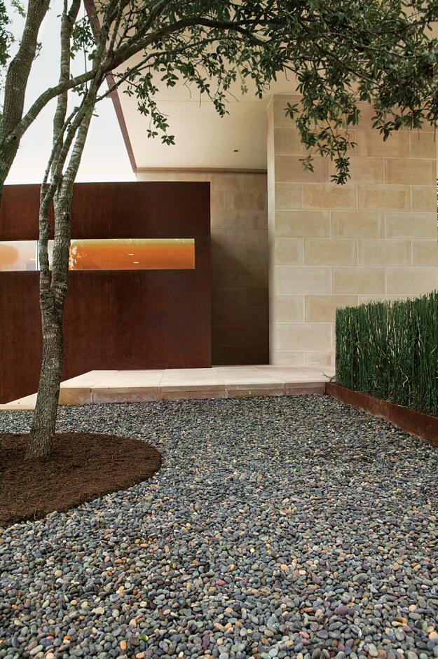 Live oak surrounded by Mexican beach pebbles and cut limestone