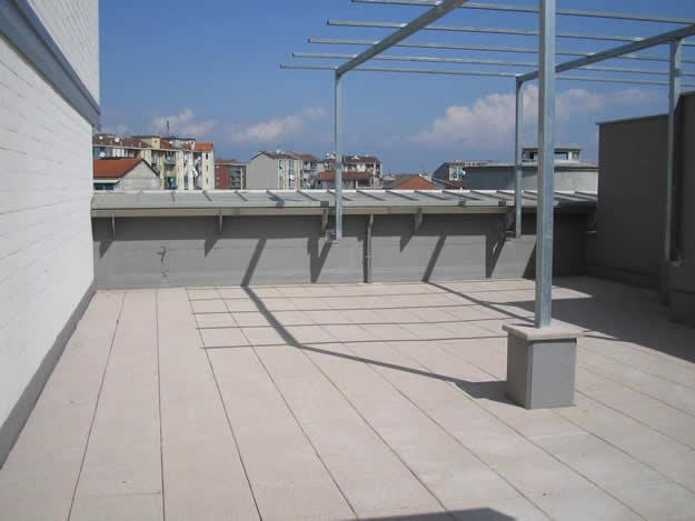 original monochromatic rooftop patio
